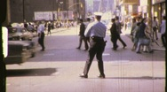 Stock Video Footage of Traffic Cop Policeman Directs Traffic Circa 1975 (Vintage Film Home Movie) 792