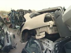 Seat, radiator, body, tyre and many other car parts. Car dump. Stock Footage