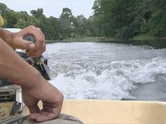 Man driving motor boat and waves. Boat engine with human hand. Stock Footage