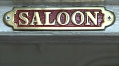 Old Brass Saloon sign Stock Footage
