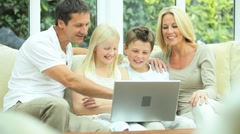 Young Family Using Laptop for Webchat - stock footage