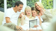 Young Family Using Wireless Tablet for Webchat Stock Footage