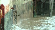 Waves splashing against wall Stock Footage