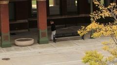 Disheveled woman shuffles through Amtrak station Stock Footage