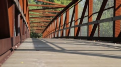 Runner on Bridge - dolly shot Stock Footage