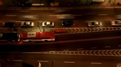 Timelapse of Night traffic at bus stop Stock Footage