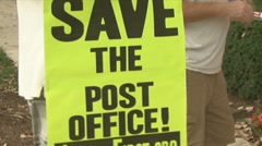 Postal workers rally to keep jobs - stock footage
