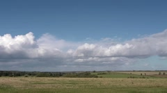 Shower clouds rolling over the cotswold countryside. Stock Footage