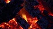 Stock Video Footage of Fire with Charred Logs, Glowing Embers, and Dancing Flames Loop