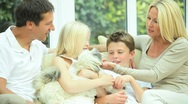 Stock Video Footage of Young Caucasian Family with Pet Dog
