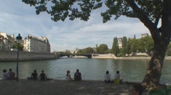Seine river people sitting and having a picnic Stock Footage