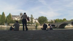 Seine river people sitting and watching Stock Footage
