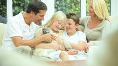 Caucasian Family Petting their Dog - stock footage