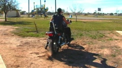 Motorcycle Burns Out In Dirt at Small City Park Stock Footage