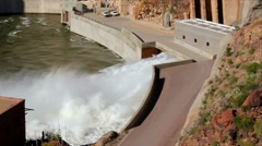 Water shooting out of discharge area of a hydroelectric dam. Stock Footage