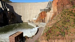 Dam with hydroelectric water ejecting through the turbine discharge area Stock Footage