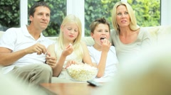 Caucasian Family Watching Movies with Popcorn Stock Footage