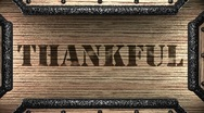 Thankful on wooden stamp Stock Footage