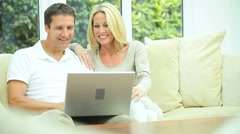Attractive Caucasian Couple Using Laptop at Home Stock Footage
