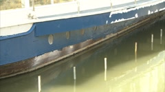 Portholes of a boat on a river Stock Footage