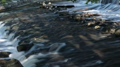 Water flowing over dam spillway Stock Footage