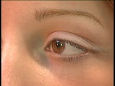 Stock Video Footage of Patient's eye in optical eye exam.