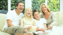Caucasian Family Watching Movies with Popcorn - stock footage