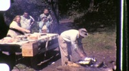 Stock Video Footage of Family Picnic TABLE Lunch Eating Dinner 1950s Vintage Film Retro Home Movie 846