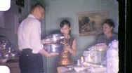 Stock Video Footage of WAR Bride ASIAN and Groom Viewing Wedding Gift 1960s Vintage Film Home Movie 849