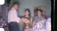 Stock Video Footage of NEWLYWEDS Bride Groom Viewing Wedding Gifts 1960s Vintage Film Home Movie 850