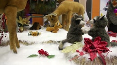 Group of moving plush toy animals on artificial snow Stock Footage