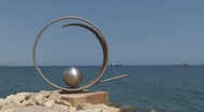 Metal artwork by the sea Stock Footage