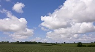 Clouds flying over rural farmland landscape Stock Footage