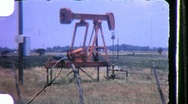 OIL WELL Pumping Drilling for Oil RIG DERRICK 1960s Vintage Film Home Movie 854 Stock Footage