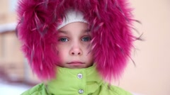 Little girl in fur hood buttoned at collar Stock Footage