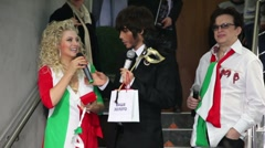Stylist Sergei Zverev and journalists at Venetian costume masquerade in boutique Stock Footage