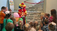 Stock Video Footage of Clown talks to children at premiere of Tales Magic Alphabet in Another Theater