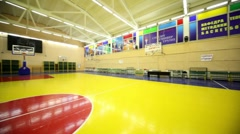 Inside lighted school gym hall with basket - stock footage