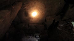 Torchlight reveals Equinox Stone in Passage Tomb, Loughcrew Ireland GFHD - stock footage