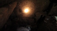 Torchlight reveals Equinox Stone in Passage Tomb, Loughcrew Ireland Stock Footage