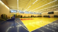 Inside lighted blue yellow school gym hall with basket Stock Footage