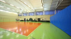 Volleyball net inside lighted school gym hall Stock Footage