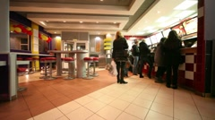 Several people stand in front of counter in cafe Stock Footage