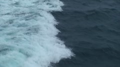 Foamed water moves over the dark sea Stock Footage