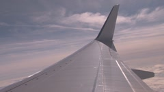 Plane wing in the sky with clouds Stock Footage