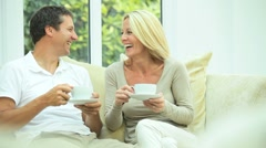 Laughing Couple Relaxing at Home Stock Footage