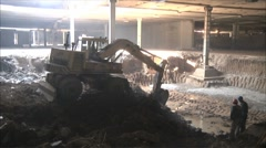 excavator digs the ground - stock footage