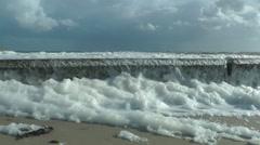 Heavy wind blowing into foam near North Sea, Germany Stock Footage