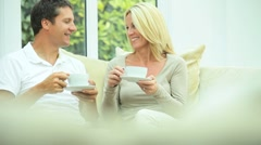 Caucasian Couple Drinking Coffee at Home Stock Footage