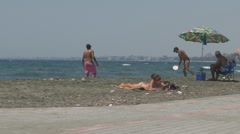 Playing beachball with topless woman on front Stock Footage